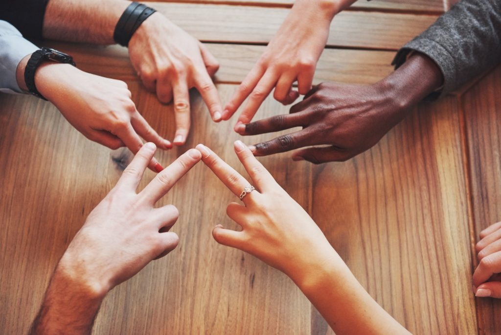 Young people putting their hands together. Friends Doing a Star Shape with fingers